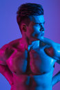 Beautiful athletic bodybuilder male model posing in studio. Muscular healthy sexy body. Expression on camera. Mixed Royalty Free Stock Photo