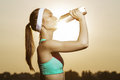 Beautiful athletic woman is drinking pure water from the bottle Royalty Free Stock Photo
