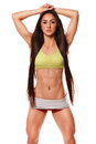 Beautiful athletic woman with long hair posing. Fitness girl showing muscular athletic body, abs. Isolated Royalty Free Stock Photo