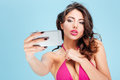 Beautiful attractive stylish girl making selfie with smartphone Royalty Free Stock Photo