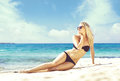 Beautiful and attractive woman in black bikini. Young girl posin Royalty Free Stock Photo