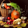 Beautiful autumn harvest of vegetables and leaves on black background Royalty Free Stock Photo