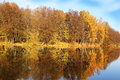 Beautiful autumn park. Autumn in Minsk. Autumn trees and leaves. Autumn Landscape.Park in Autumn. Mirror reflection of trees in wa Royalty Free Stock Photo