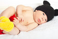 Beautiful baby boy in crochet costume laying colorful Royalty Free Stock Image