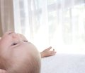 Baby boy is lying and looking up Royalty Free Stock Photo