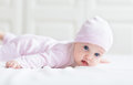 Beautiful baby girl with big blue eyes in pink kni a knitted hat Stock Photography