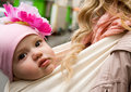 Beautiful baby girl carried in sling Stock Images
