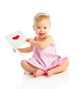 Beautiful baby girl with cute valentine postcard with a red hear