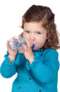 Beautiful baby girl with drinking Stock Images