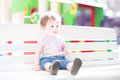 Beautiful baby girl enjoying sun on playground the a Royalty Free Stock Images