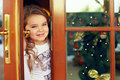 Beautiful baby girl looking out from door Royalty Free Stock Photography
