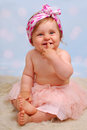 Beautiful baby girl months studio portrait of with fingers in her mouth Stock Photos