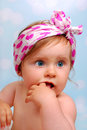 Beautiful baby girl months studio portrait of with fingers in her mouth Royalty Free Stock Photo