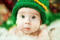 Beautiful baby in green knitting hat Stock Photos
