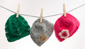 Beautiful baby hats three small hanging on line Royalty Free Stock Photos