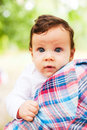 Beautiful baby portrait sitting on her parent s shoulder and looking curious Royalty Free Stock Image