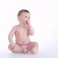 Beautiful baby sitting on the floor isolated Royalty Free Stock Photo