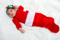 Beautiful baby in a stocking girl inside christmas Stock Photos