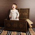 Beautiful baby with suitcase little girl sitting in Royalty Free Stock Image