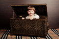 Beautiful baby with suitcase little girl sitting in Royalty Free Stock Photos