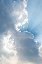 Beautiful background bright sun shines through clouds, light ray Royalty Free Stock Photo
