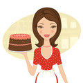 Beautiful baker holding cake Royalty Free Stock Photography