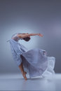 The beautiful ballerina dancing in blue long dress Royalty Free Stock Photo