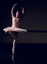 Beautiful ballerina dancing en pointe in the dance studio Royalty Free Stock Photos