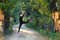 Beautiful ballerina girl jumping high in the air in autumn forest Royalty Free Stock Photo