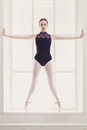 Beautiful ballerina stands in releve ballet position Royalty Free Stock Photo