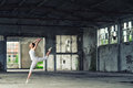 Beautiful ballerina in white dancing and jumping high in the air Royalty Free Stock Photo