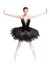 Beautiful ballerine stands in releve ballet position Royalty Free Stock Photo