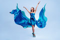 Beautiful ballet dancer flowing blue fabric dancing grace studio Stock Photos