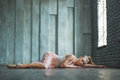 Beautiful ballet dancer lying on floor Royalty Free Stock Photo