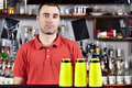 Beautiful barmen in red polo Royalty Free Stock Photos