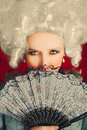 Beautiful baroque woman portrait with wig and fan style of a young behind a hand Royalty Free Stock Photos