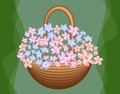 Beautiful basket with cute blue and pink flowers on green background, greeting decoration, birthday party,