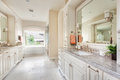 Beautiful bathroom in new home with dual sinks master large vanity tile floors and Stock Image