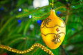 Beautiful bauble on christmas tree gold Royalty Free Stock Image