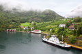 Beautiful bay of Sognefjord near wooded mountain Stock Images