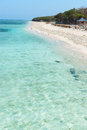Beautiful beach with blue clean water and cafe Royalty Free Stock Photo