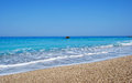 Beautiful beach crystal clear blue sea interesting small stones greece Royalty Free Stock Image