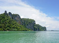 Beautiful beach with crystal clear blue waters of the andaman sea against sky at krabi bay thailand Stock Image