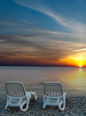 Beautiful beach with deck chairs at sunset Royalty Free Stock Image