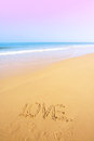 Beautiful beach with sand, blue waves and sky Royalty Free Stock Photo