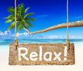 Beautiful beach scenery with palm tree coconut and a sign relax Royalty Free Stock Images