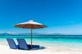 Beautiful beach. Sunbeds with umbrella on the sandy beach near the sea. Royalty Free Stock Photo