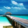 Beautiful beach with water bungalows at maldives Stock Photos