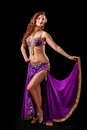 Beautiful belly dancer  holding out skirt Royalty Free Stock Photo