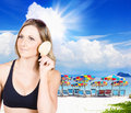 Beautiful bikini model listening to natures calm young woman holding a shell her ear in black Royalty Free Stock Photo